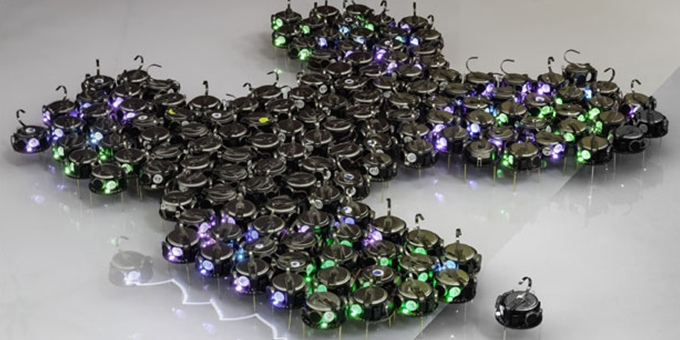 Hundreds of Tiny Robots Grow Bio-inspired Shapes