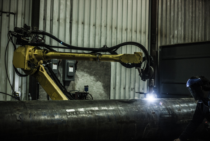 Groupe Gravel's robot work cell performs plasma cutting and welding on large workpieces at the company's Quebec facility