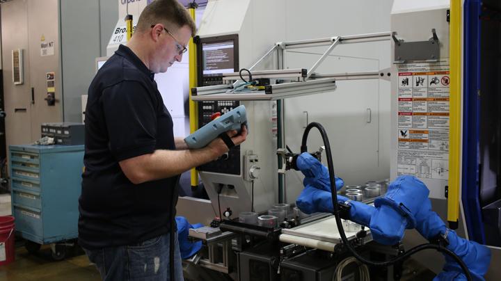 Task Force's UR5 collaborative robot setup at CNC machine